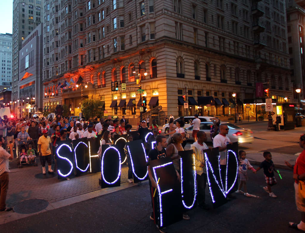 Protesters marching against education cuts on Broad Street last month. The protest began as a candlelight vigil at Gov. Corbett´s Philadelphia office.