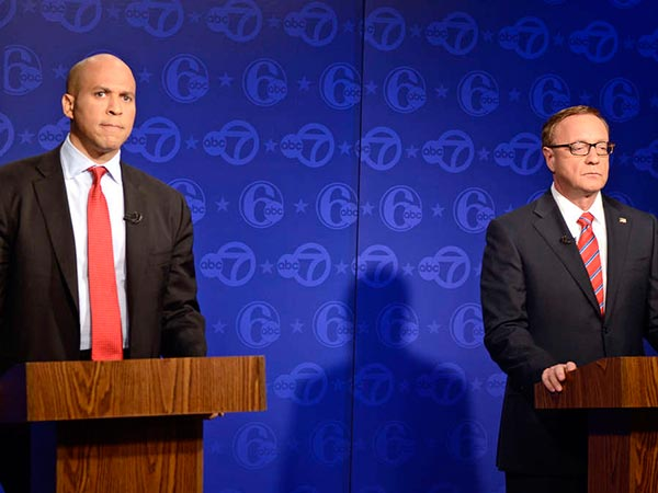 Newark Mayor Cory Booker (left) and U.S. Senate rival Steve Lonegan, seen in their first debate last week. TOM GRALISH / Staff Photographer