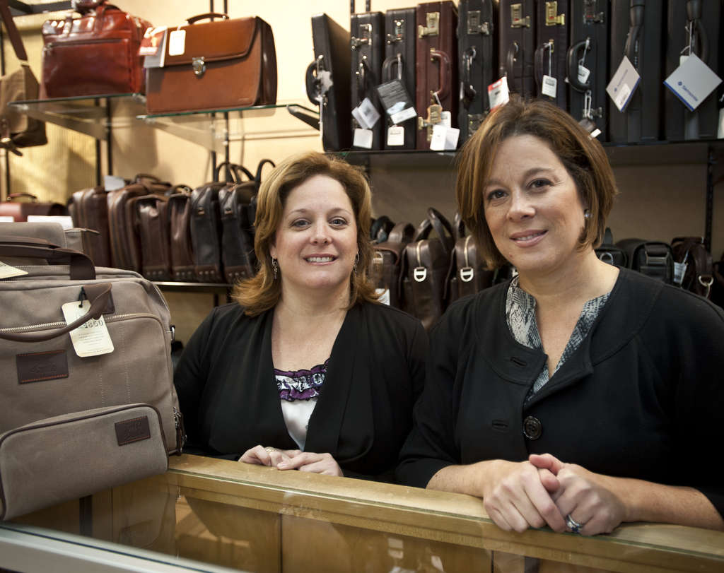 Co-owners and sisters Nancy Center (left) and Sharon Laudenbach have worked at Robinson Luggage since childhood, when their parents ran the company. Robinson is closing its last location, at Broad and Walnut, most likely in December.