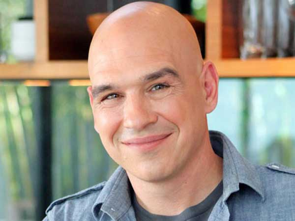 "Michael Symon appears on ""The Chew"" and ""Iron Chef."""