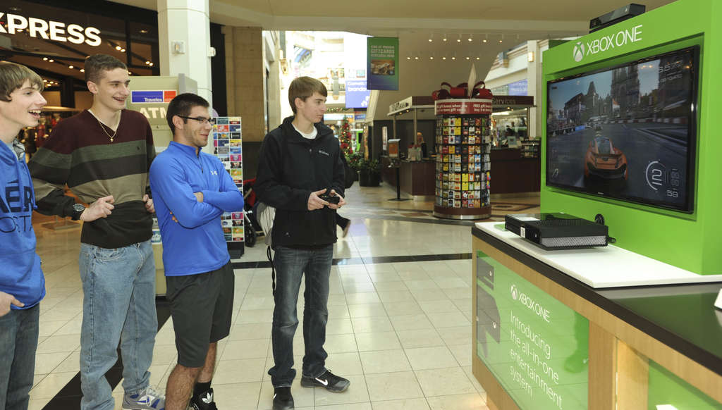 While on a field trip from Nazareth Area High School to the King of Prussia Mall, (from left) Mitchell Wilson, Justin Wintle, John Weaver, and Michael Boucher stop to try out an Xbox One. Microsoft´s new gaming console goes on sale at 12:01 a.m. Friday.