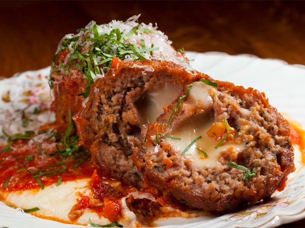 An appetizer of B+V+P meatballs, stuffed with oozy fontina, comes with polenta.