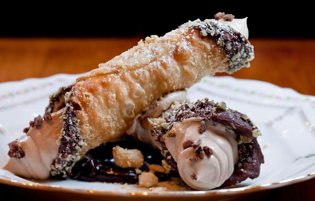 The cannoli have a bubbly shell, creamy hazelnut-ricotta filling, and chocolate nibs.