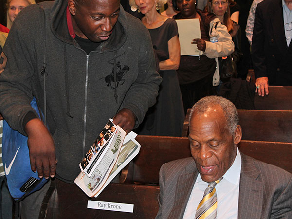 Darrell, left, from One Step Away, meets actor and director Danny Glover at a recent Witness to Innocence event at Friends Center