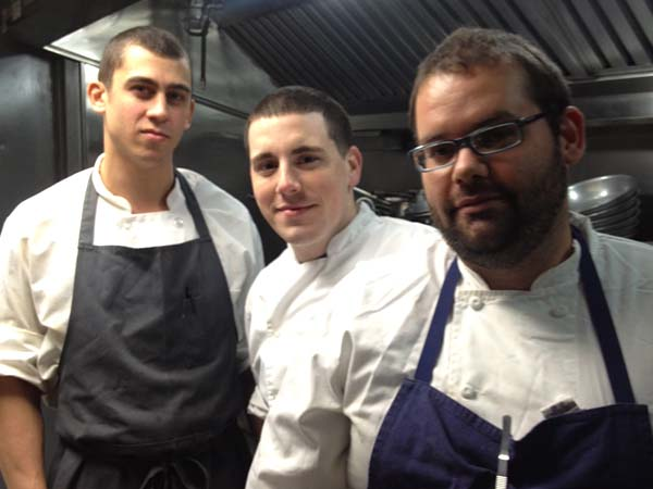 Chef Kevin D'Egidio (right) in the kitchen at Stateside with sous chef Geno Betz (center) and Blaise Sideris.