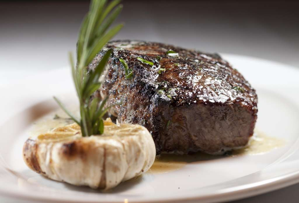A 16-ounce Kansas City strip steak had a rosy, complex succulence. The roasted Chinese garlic head served with it, however, turned an eerie blue-gray instead of deep brown.