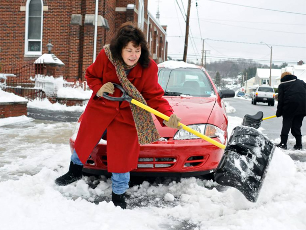 Kim Weiss, Saint Clair, Pa., helps shovel out the car of her friend Lucy Fox, back right, on Lawton Street in Saint Clair, Sunday, Dec. 15, 2013. Two extremely fast-moving clippers look to be moving in Tuesday, and the latter system may turn out to be the one to watch.