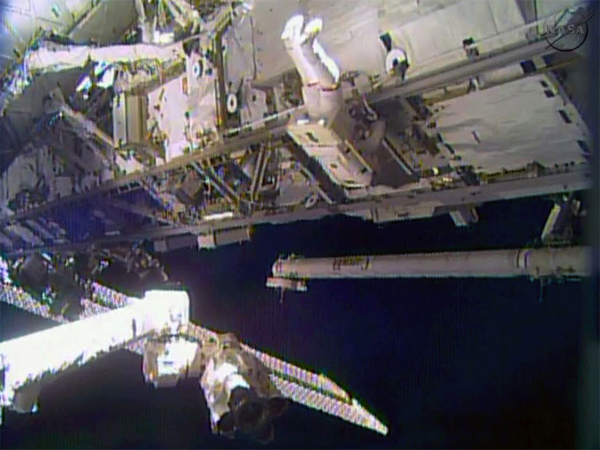 In this image made from video provided by NASA, astronaut Rick Mastracchio performs a space walk outside the International Space Station on Saturday, Dec. 21, 2013. Mastracchio and Michael Hopkins ventured out of the station to try to revive a crippled cooling line.