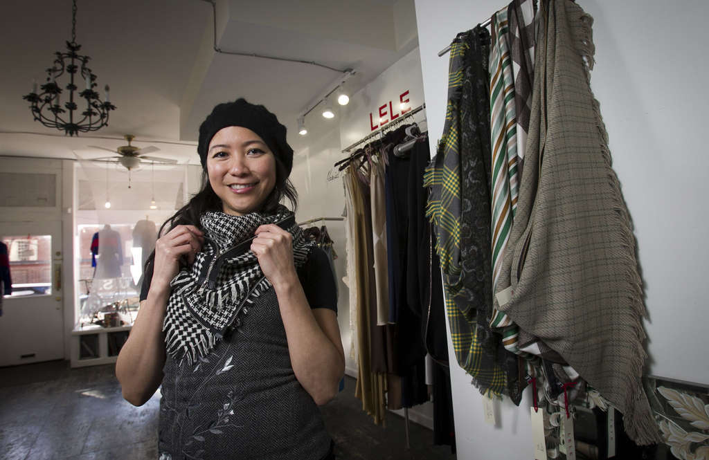 ALEJANDRO A. ALVAREZ / STAFF PHOTOGRAPHER Lele Tran sells her wares, including her multifunctional scarves, out of the US*U.S. co-op in Old City.