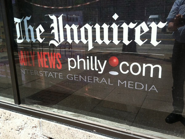 Sign outside 801 Market St. entrance to Interstate General Media, home of The Inquirer, Daily News and Philly.com (Reid Kanaley/Staff)