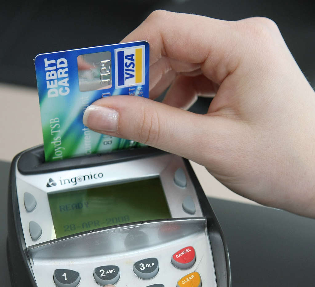 Most of the world now uses payment cards embedded with microchips, but the United States clings to outmoded magnetic-stripe technology.