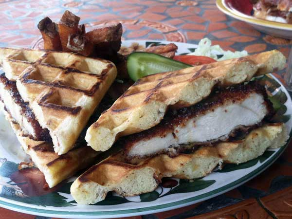 Porto´s Yo Cuz, a chicken cutlet between two bacon-cheddar waffles.