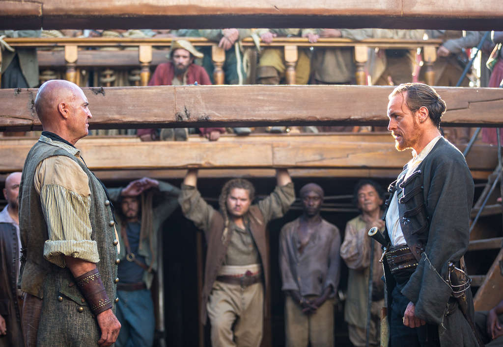 "Anthony Bishop (left) as Singleton, Toby Stephens as Captain Flint. The series has real historical pirates and ""Treasure Island"" pirates."