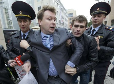 A gay rights activist is detained in a September protest outside the Winter Olympics´ organizing committee office in Moscow.