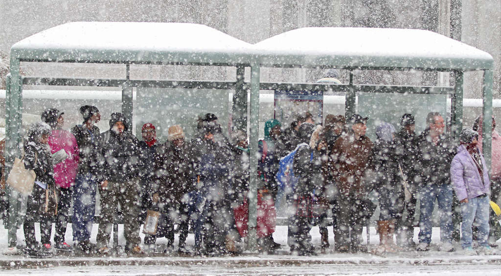 """At a crowded stop on snowy Tuesday, passengers wait for a bus that might already be full and won´t stop. The long cold snap has only increased the crowding, and what SEPTA calls """"pass-ups."""""""