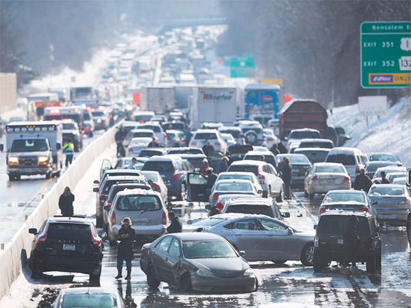 Vehicles are piled up in an accident on the Pennsylvania Turnpike in Bensalem. (AP Photo/Matt Rourke)