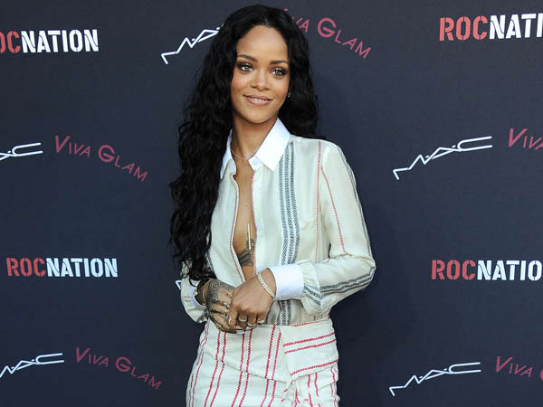 Rihanna arrives at the Roc Nation 2014 Pre-Grammy Brunch Celebration on Friday, Jan. 25, 2014 in Los Angeles. The Barbadian singer will be the voice of Tip in DreamWorks Animation´s new film, ´Almost Home.´ (Photo by Jordan Strauss/Invision/AP)