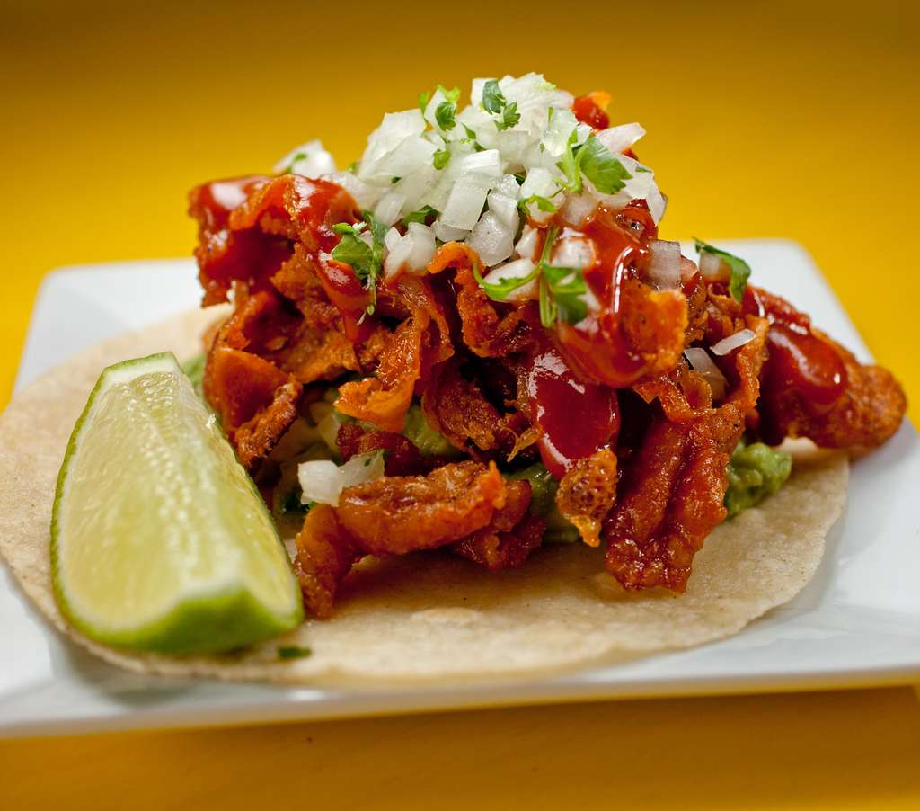 Tacos piled with crispy chicken skins tossed in vinegar-tanged chile de arbol salsa could become a citywide favorite.