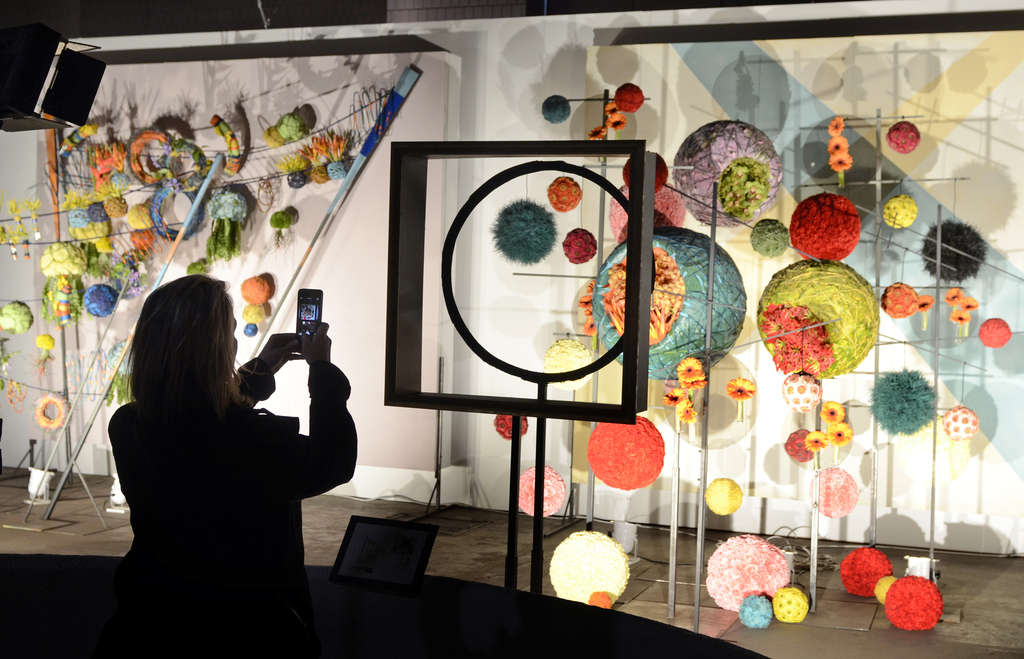A visitor photographs the Schaffer Designs display inspired by the current exhibit of works of Wassily Kandinsky at the Guggenheim Museum in New York City. She was at the Philadelphia Flower Show´s preview for members of the Pennsylvania Horticultural Society on Friday. The show opens Saturday at the Convention Center. See www.inquirer.com for comprehensive coverage. Story, B1.