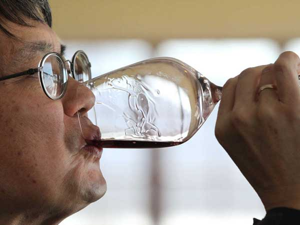 Mark Chien, Penn State Extension viticulture educator, tastes Galen Glen´s Crooked Stick Red.   MICHAEL BRYANT / Staff Photographer