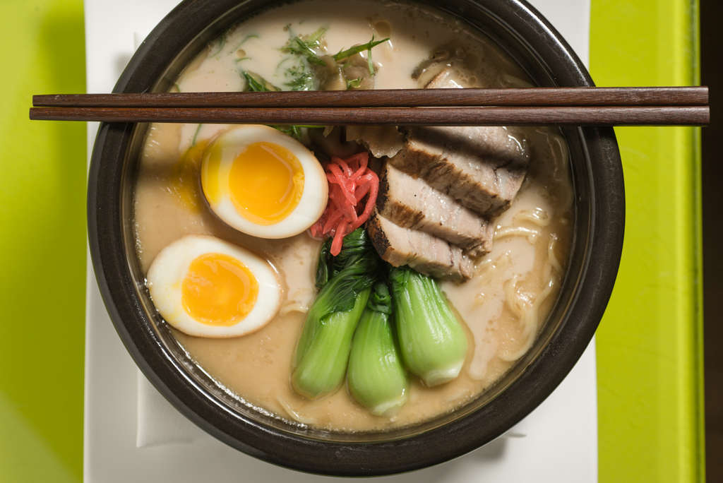 Morimoto´s tonkotsu ramen is a rich soup of pork broth, scallion, pickled red ginger, soy-marinated egg, pickled turnip, bork belly, and bok choy.MATTHEW HALL / Staff Photographer