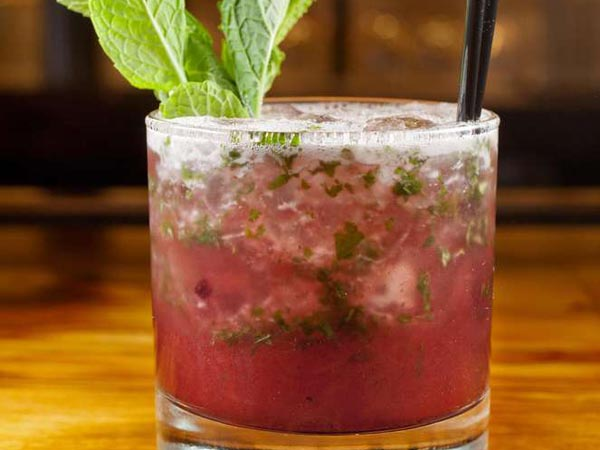Blackberry mint julep with Four Roses bourbon, blackberry preserve and mint leaves as served at The Fat Ham, 3131 Walnut St., Philadelphia, March 6, 2014.  ( DAVID M WARREN / Staff Photographer )