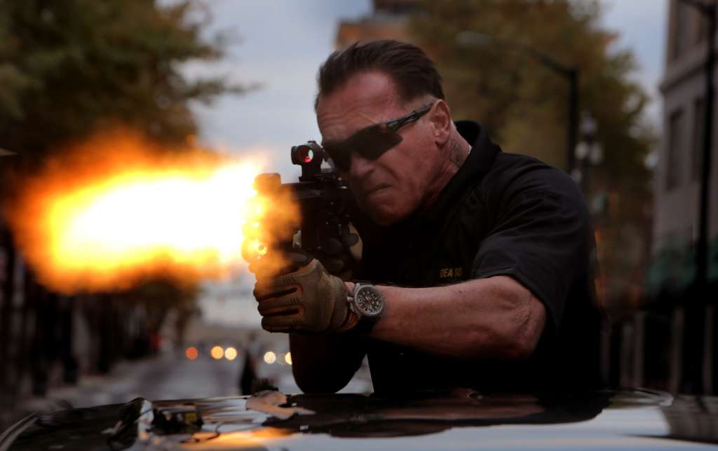 """Arnold Schwarzenegger as Breacher in """"Sabotage."""" Action, more action, and yet more confusing, preposterous action."""