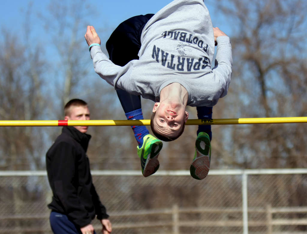 Springfield Township junior Chris Stone, an aspiring decathlete, practices the high jump at La Salle, where his father coaches. Watching is La Salle´s Mike Koller.