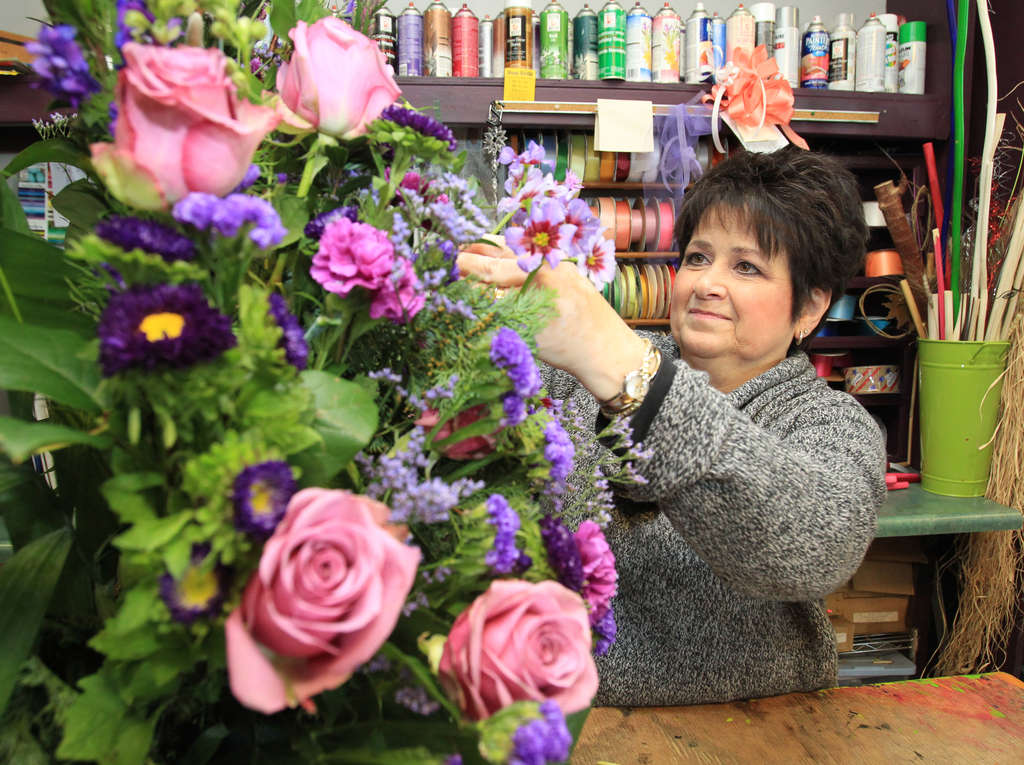 Flowers by David co-owner Robin Heller at the Langhorne shop. Hers is among florists battling websites that pass themselves off as real shops and undercut local profits.