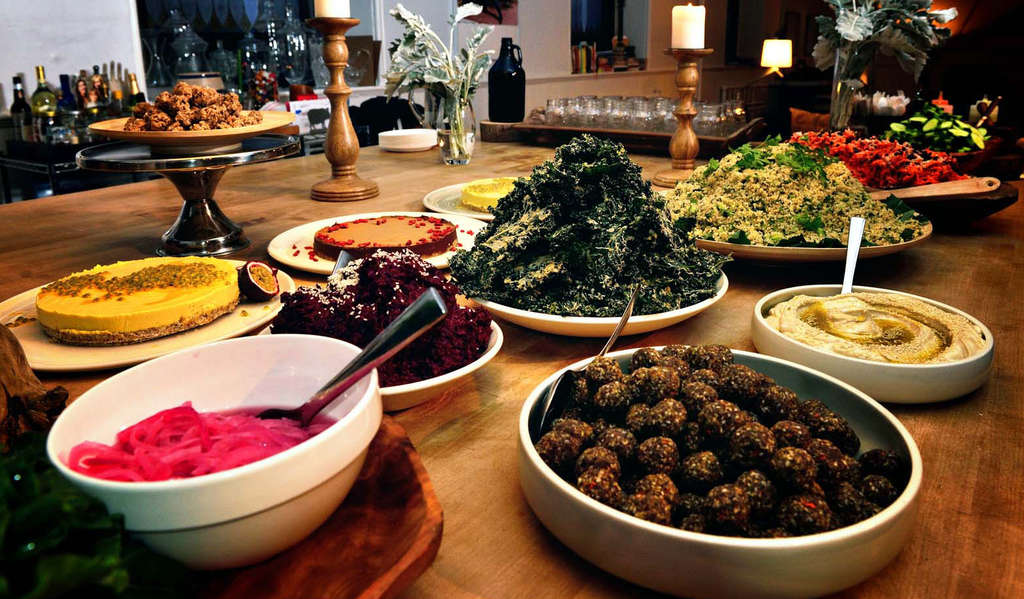 A raw vegan buffet of falafel wraps, tahini kale, pineapple mousse cake with fresh passion fruit, among other delectables.