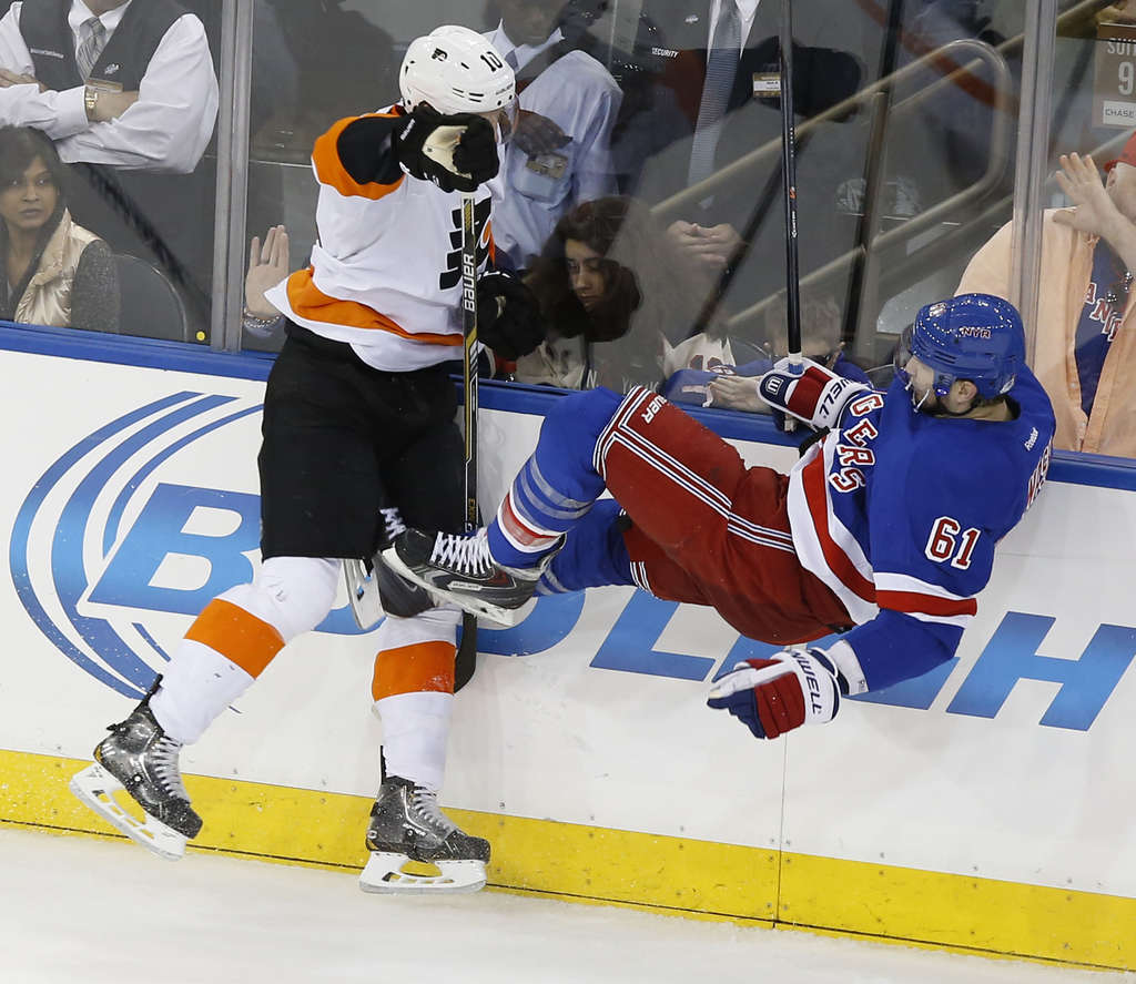YONG KIM / STAFF PHOTOGRAPHER Brayden Schenn gives Rangers forward Rick Nash a seat on the ice with a second-period hit.