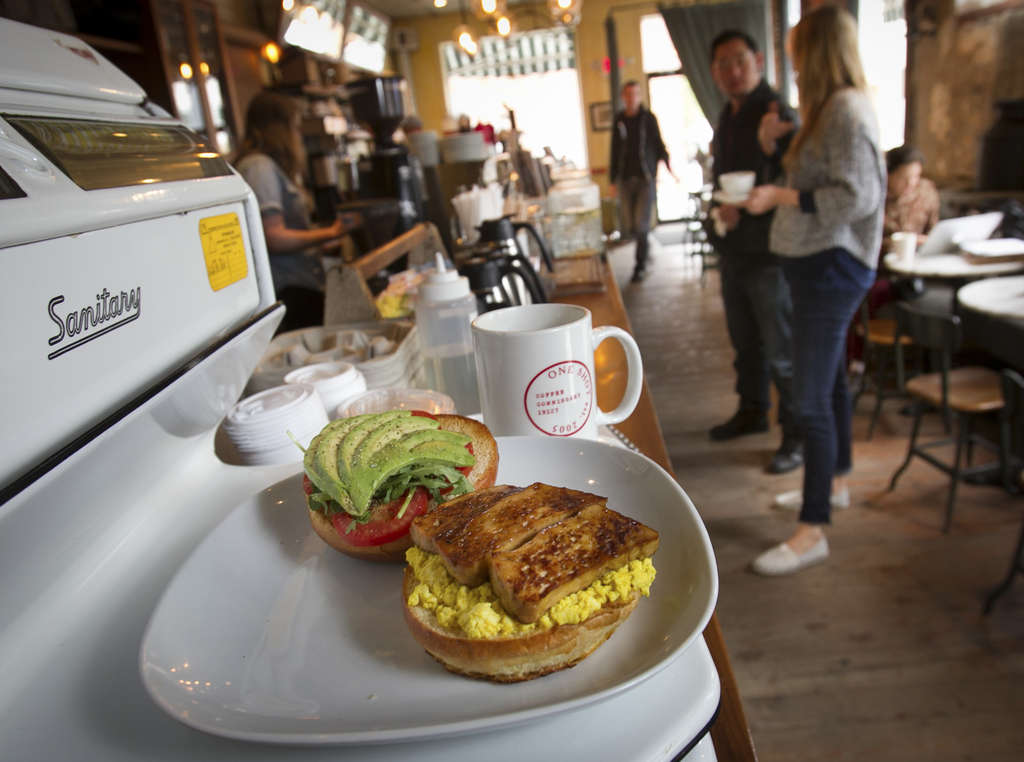 ALEJANDRO A. ALVAREZ / STAFF PHOTOGRAPHER At One Shot Cafe , a fresh avocado and tomato sandwich with in-house-made vegan bacon awaits the nonmeat eater . . . or anybody.