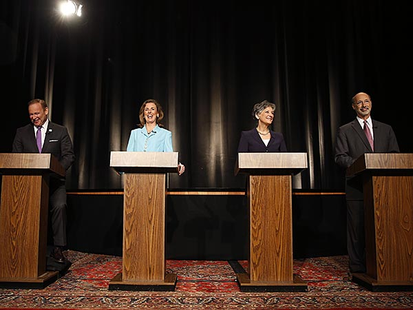 State treasurer Rob McCord, from left, and former state environmental protection secretary Katie McGinty laugh as U.S. Rep. Allyson Schwartz and businessman Tom Wolf wait for the start of a Pennsylvania Democratic Gubernatorial Primary Debate, Thursday, May 8, 2014, in Philadelphia. (AP Photo/Matt Slocum)