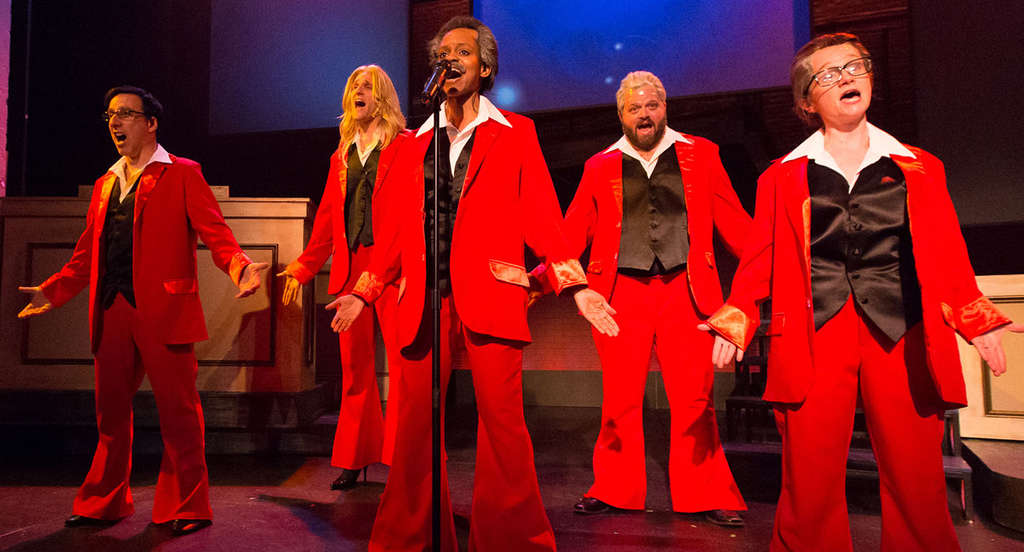 """The cast of """"This Is the Week That Is"""" delivers one of their musical comedy numbers."""