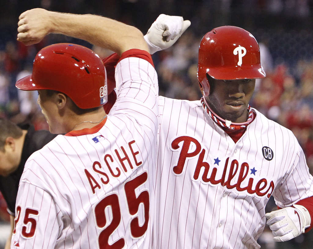 RON CORTES / STAFF PHOTOGRAPHER Domonic Brown is greeted by Cody Asche after Brown´s fourth-inning home run on Saturday night.