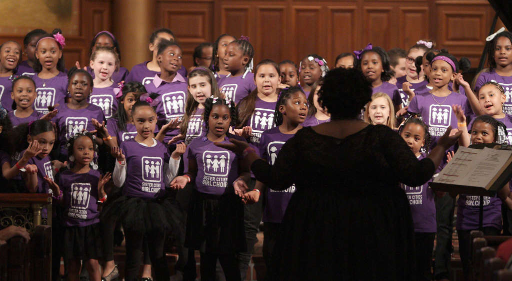 Members of the Sister Cities Girlchoir perform during their fundraising concert Sunday at the Church of the Holy Trinity in Center City.