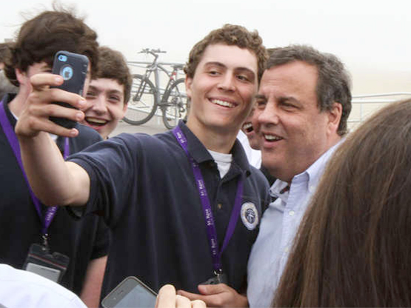 "A supporter snaps a selfie with Gov. Christie in Belmar over the Memorial Day weekend. ""This place looks a heck of a lot different than when I stood here in October 2012,""Christie said."