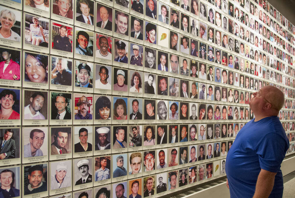 Jim Jenca of Levittown , who was injured at the scene, visits the September 11 Memorial Museum during a special opening for survivors and victims´ families. Here, he views portraits of those who died. CLEM MURRAY / Staff Photographer