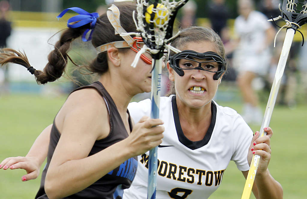 Moorestown´s Jessica Dadino shadows Princeton´s Oona Ryle in the Quakers´ 17-5 winin the South Jersey Group 3 championship game.