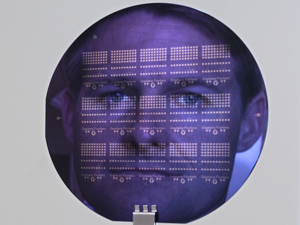 Graphene Frontiers CEO Mike Patterson is seen reflected in a diagnostic chip wafer in his company´s lab in Philadelphia on May 19, 2014. ( DAVID MAIALETTI / Staff Photographer )