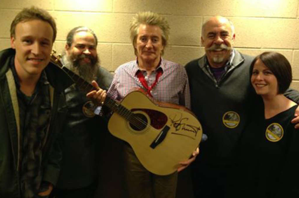 Dave Gibson (from left), Rob Calvert, Rod Stewart, John DeBella and Jen Posner hang out back stage at Wells Fargo Center.