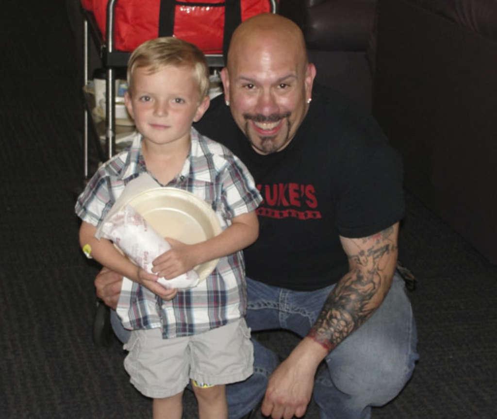 Tony Luke Jr., pictured with Brayton Martin, 5, visited the Alfred I. duPont Hospital for Children on Tuesday.