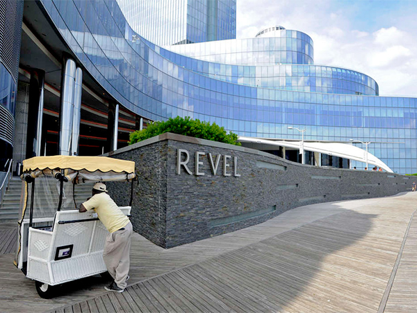 Rolling Chair operator Jean Desir waiting for fares near the Revel in Atlantic City on Thursday.