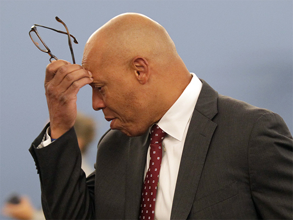Superintendent of The School District of Philadelphia William Hite scratches his head while arriving to a public meeting to adopt a operating budget for 2014/2015 at the Philadelphia School District Building on Monday, June 30, 2014. The Pa. Senate´s action on Tuesday delays a cigarette tax that would raise millions for Philly schools. ( YONG KIM / Staff Photographer )