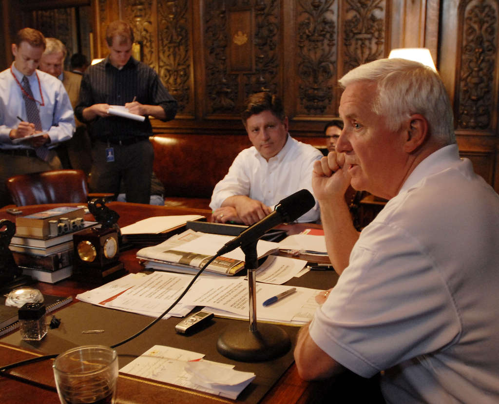 BRADLEY C. BOWER / ASSOCIATED PRESS Gov. Corbett (right) and Lt. Gov. Jim Cawley discuss the state budget, which Corbett has yet to sign, at a news conference Sunday.