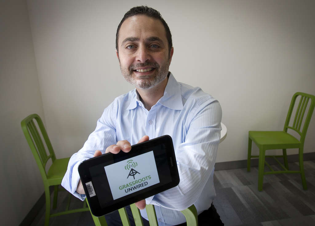 ALEJANDRO A. ALVAREZ / STAFF PHOTOGRAPHER Russ Oster, founder and CEO of Grassroots Unwired, is helping nonprofits become more efficient with his GPS-enabled technology that tracks, reports and analyzes the activities of canvassers.