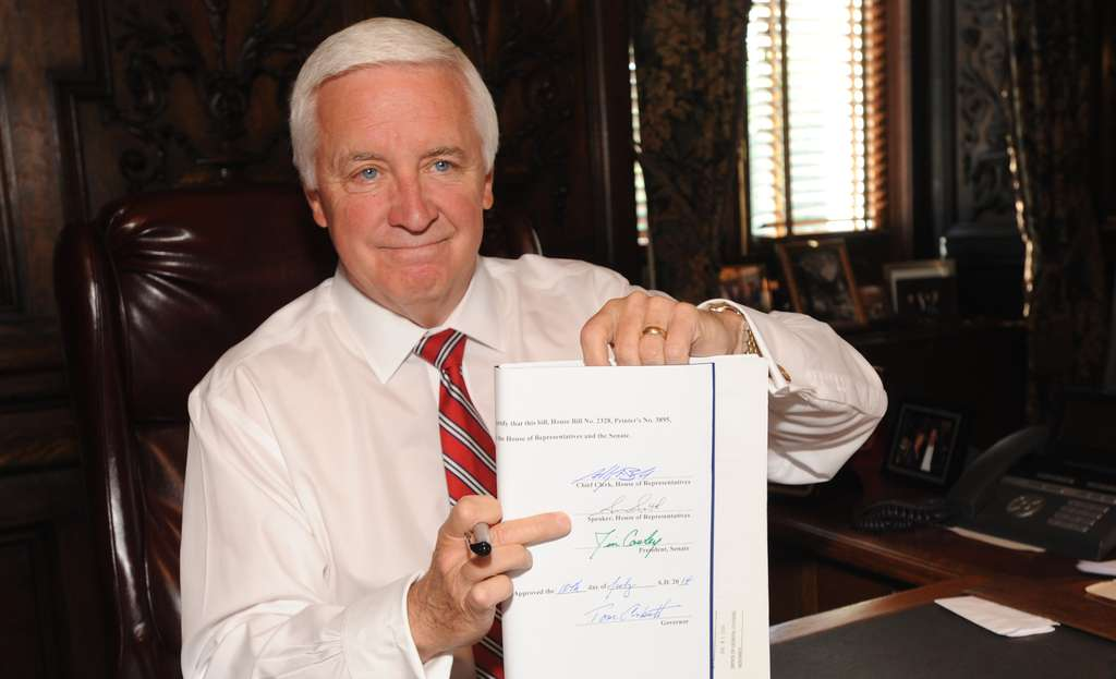 BRADLEY C. BOWER / ASSOCIATED PRESS Gov. Corbett gave his John Hancock to the state budget yesterday. He´s using millions to work on pension reform, an issue state voters say isn´t a crisis, poll shows.