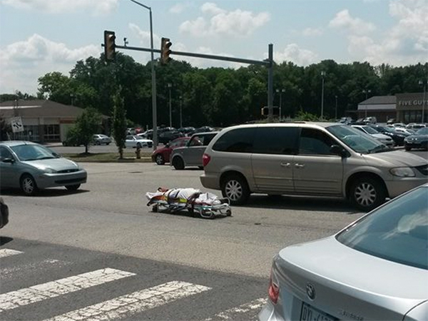 A dead body on a gurney fell out of a coroner´s van when a door malfunctioned, sending the corpse into the middle of a busy roadway in Bucks County.