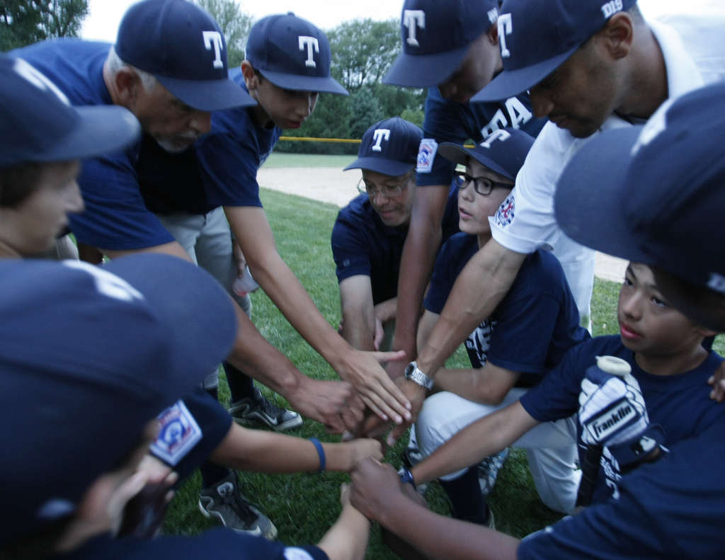 Manager Alex Rice gathers the Taney Dragons after practice. The racially diverse Pennsylvania Little League championship squad also includes Mo´ne Davis, the only girl playing on any of the state´s eight top teams.