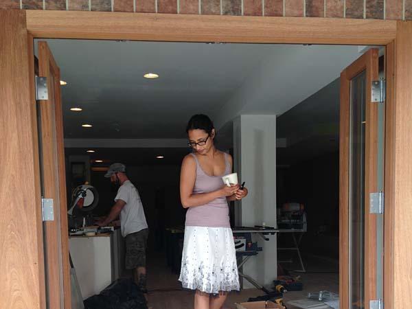 "Varnana ""V"" Beuria in the window of her new Chhaya Cafe."